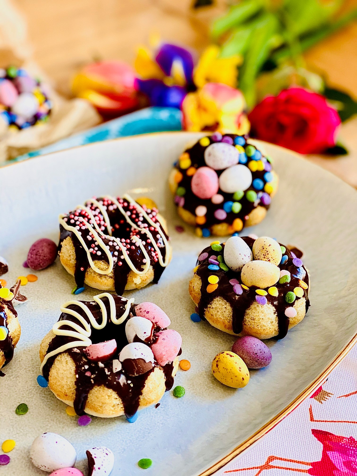 Easter baked doughnuts. Easter egg nests with a difference. Decorated with chocolate ganache, sprinkles and mini eggs