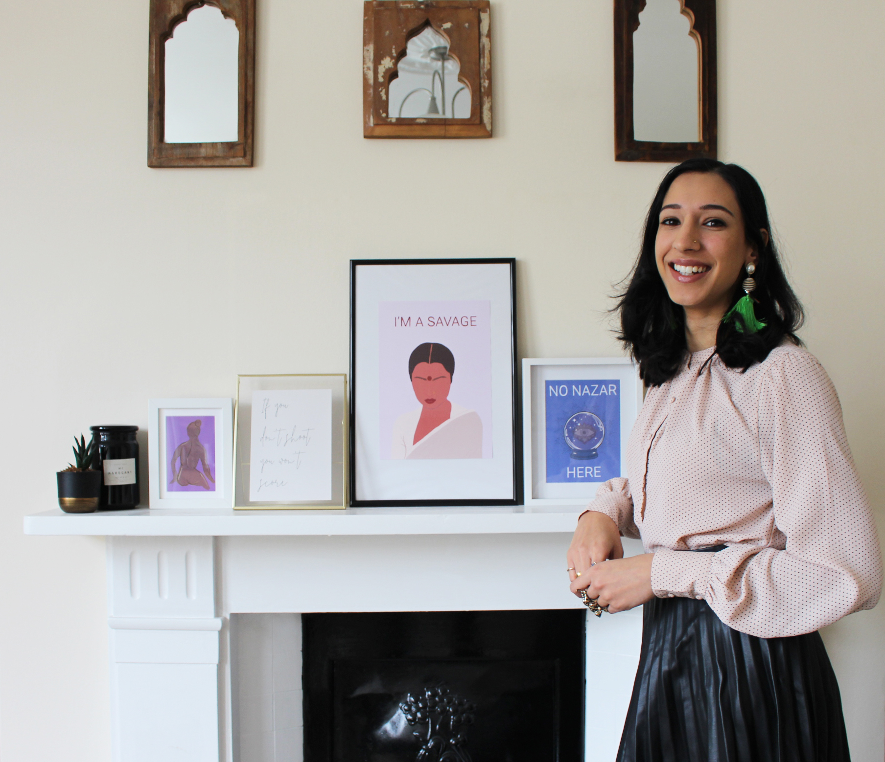An image promoting Jatinder Creates; the maker is standing next to a selection of her artwork inspired by her South Asian heritage